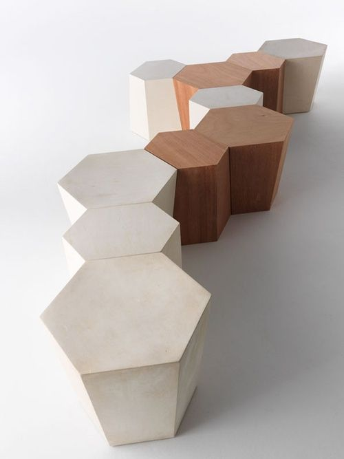Architect Steven Holl designed these hexagonal forms for Horm to be used as seating or tables. Available in stone, wood, or painted metal.