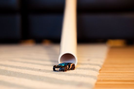 Something so simple would keep my kids entertained for hours. A long tube and a matchbox car.
