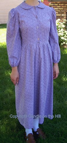 A little less severe but still lovely and simple plain dress.