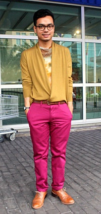 Naboonies embraced brights in pink pants and a gold cardigan, both from Uniqlo, that he wore with a cosmic print tee by Christopher Kane and a pair of vintage brogues.