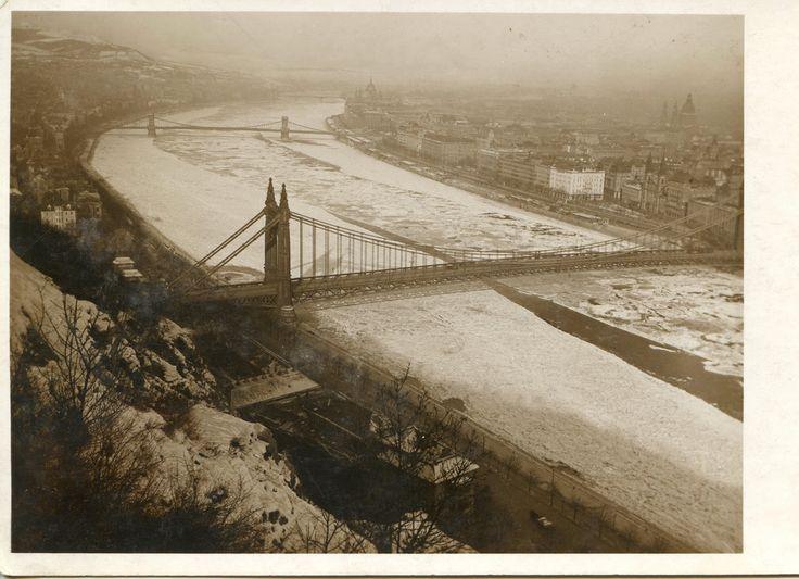 Budapest, 1920s. Frozen Danube and Elisabeth Bridge Bridges on the frozen Danube (Duna): Elisabeth Bridge (Erzsébet-híd), taken from Gellért Hill (Gellérthegy). Chain Bridge (Lánchíd) and Margaret Bridge (Margit-híd) in the background. Amateur photograph.