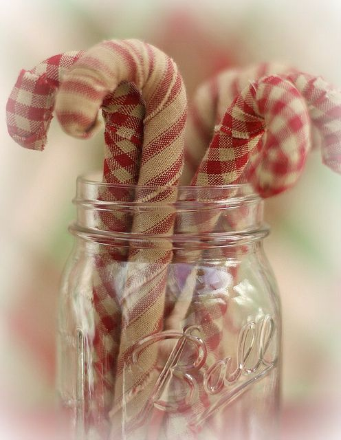 Fabric-wrapped candy canes in a mason jar look so very country.