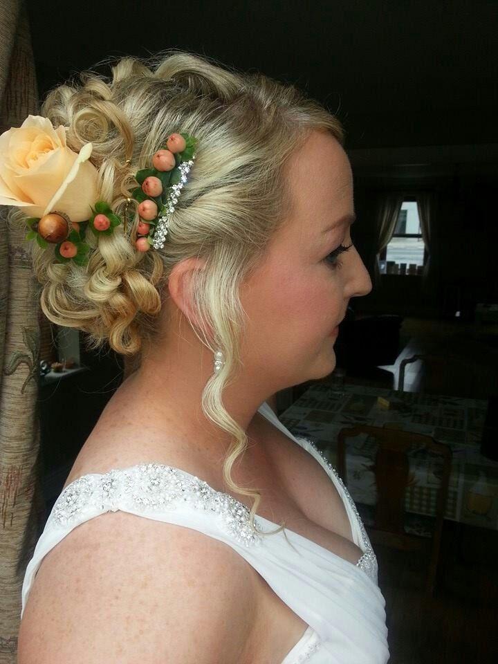 Bridal up style using fresh flowers