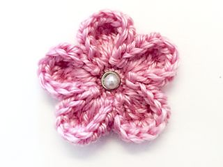 This is a simple photo tutorial for a cute little flower that you can use for an adorable embellishment. Its petals curl up and inward, giving it a little dimension.