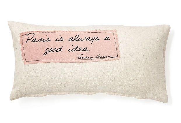 A charming accent cushion with a wonderful, homemade feel, this design is detailed with a simply stitched patch featuring a memorable Audrey Hepburn remark.