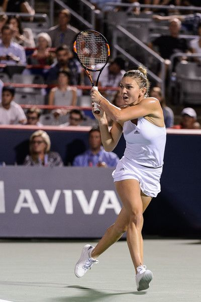Simona Halep Photos - Simona Halep of Romania hits a return against Daria Gavrilova of Australia during day two of the Rogers Cup at Uniprix Stadium on July 26, 2016 in Montreal, Quebec, Canada. Simona Halep of Romania defeated Daria Gavrilova of Australia 2-6, 3-6. - Rogers Cup Montreal - Day 2