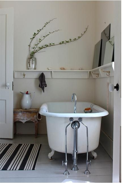 Simple Old-Fashioned Cape Cod Bath. I would have to secure those mirrors so they wouldn't come crashing down on me :)
