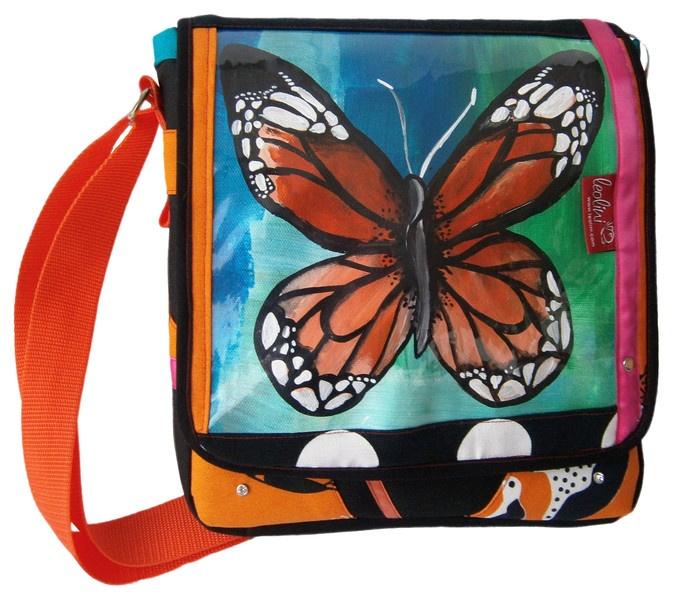 Bei deiner Tasche *Butterfly* von *leolini* sind dir die Blicke gewiss!    Bei *Butterfly* handelt es sich um ein 100% handgefertigte Handtasche.       weitere Unikat Handtaschen findest du auf leolini.com