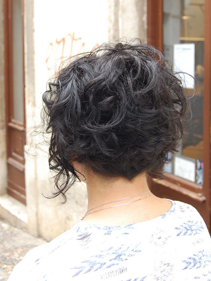 Shapely nape on this gradualed  or undercut curly bob....beautiful