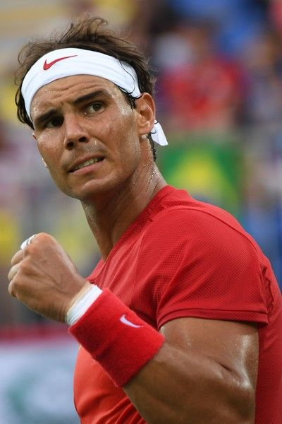 Rafael Nadal Photos - Spain's Rafael Nadal reacts after scoring a point during…