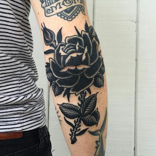 Black line rose traditional tattoo