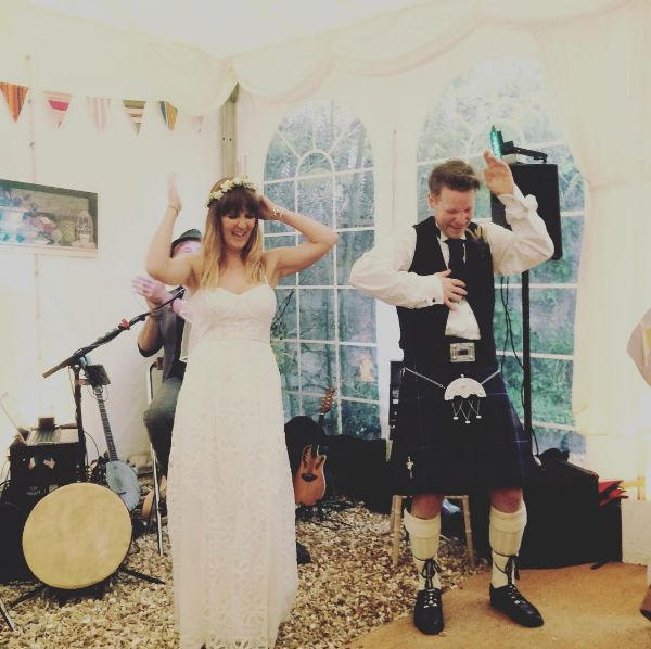 Mel and Rick Dew start the dancing at the wedding with the Macarena, May 2015, Topsham Devon. For more or to contact, go to my website at www.lucymunday.com