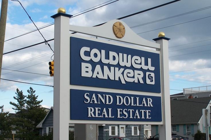 Sand Dollar Real Estate carved exterior sign created by Coastal Sign & Design www.coastalsign.net