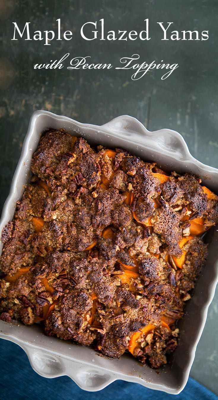 Sliced, baked sweet potato yam recipe, with maple syrup, brown sugar, and pecans. Perfect for #Thanksgiving! On SimplyRecipes.com