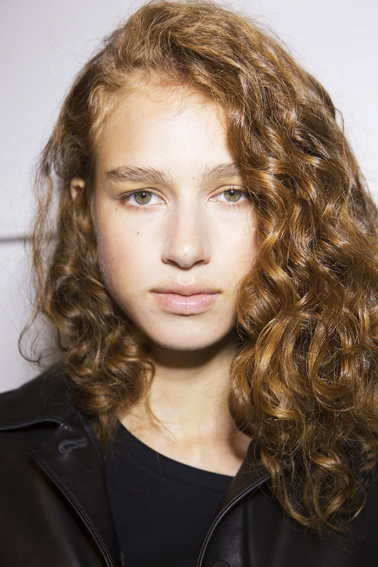 """Rewet And Reset - To reactivate product and loosen up lifeless curls, """"spray some water onto the roots and gently massage until your curls are at their desired texture,"""" says Mara Roszak, celebrity hairstylist for L'Oréal Paris."""