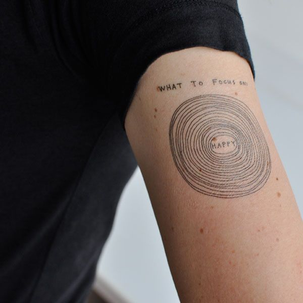 #Tattly Temporary tattoos  Focus on happy, focus on happy, focus on happy. These beautifully imperfect concentric circles make clear what you should be worried about - Happy! Focus on happy is sized to fit nicely on your wrist area to so that it serves as a quickie, friendly reminder of what's important.