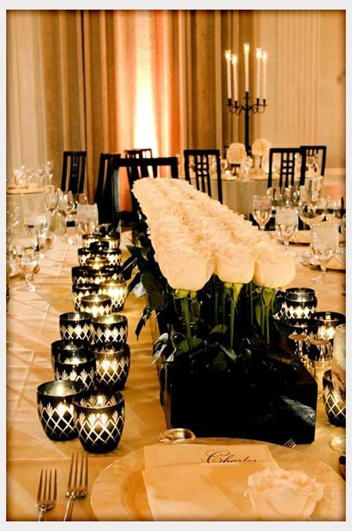 looks simple and elegant, use white roses, black or grey base & tiny bow tied around rose(black bow).