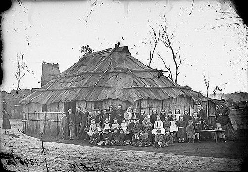 Teacher and schoolchildren outside the school, Blacklead (?), 1871-1875 / American & Australasian Photographic Company
