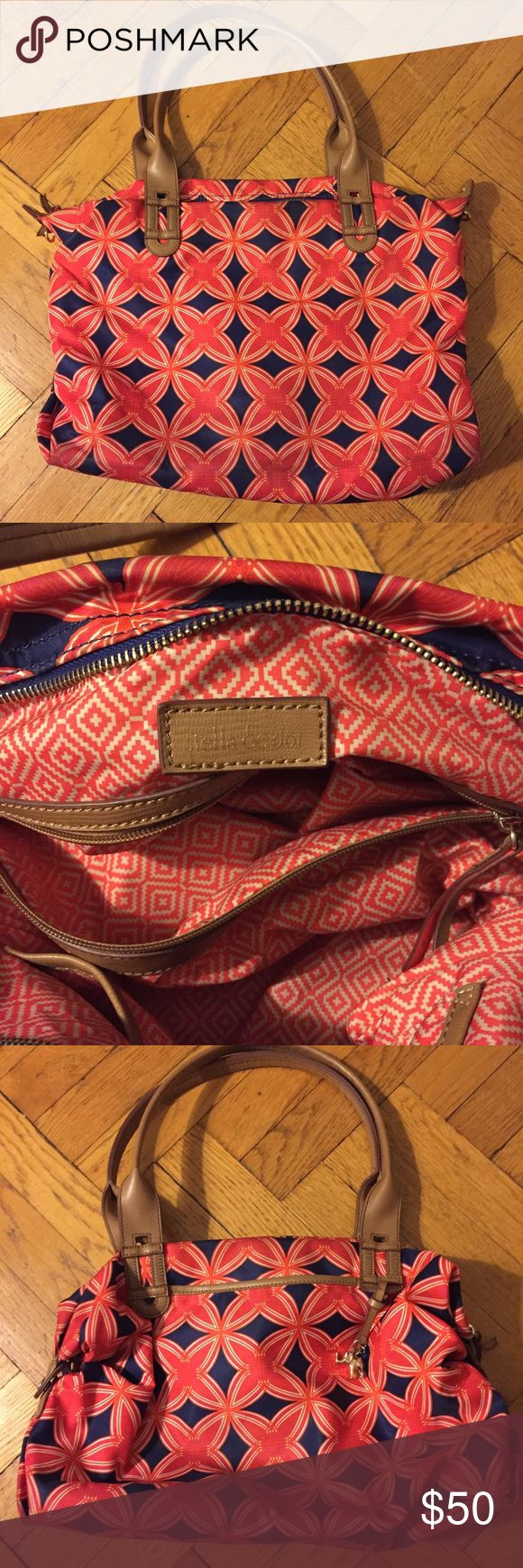 "Stella & Dot red geometric floral purse Priced to sell!! Great condition, some light wear on the bottom can be washed or spot treated. Good hardware with elephant charm. Pockets inside. Measures 17"" x 13"" x 5"" with 10"" strap drop Stella & Dot Bags Shoulder Bags"