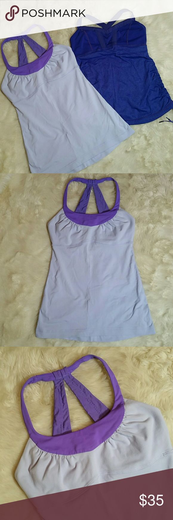 """Lululemon Bundle of Two Purple Tops Lululemon Bundle of Two Purple Tops. Two tops. The first one is Lavendar and no size dot located, measuring up to a size 4. Good preowned condition.  No rips, holes, tears or stains. The second top is violet, size dot 4. Missing the little lace caps on the left side bottom, strap has a little snip in it.   Lavendar Pit to Pit 13.5"""" Violet Pit to Pit 13.5"""" lululemon athletica Tops Tank Tops"""