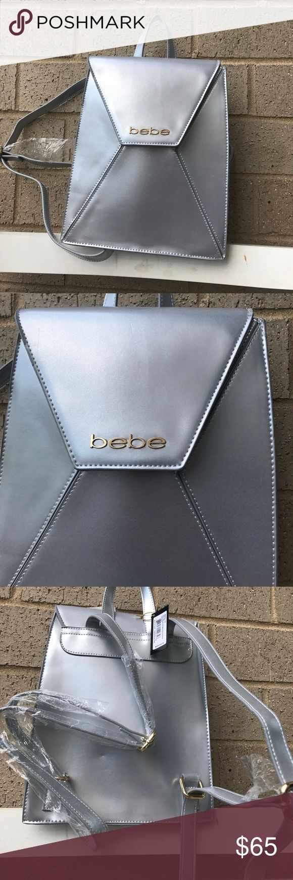 Bebe metallic silver backpack Cute fashionable accessory a must have for  this summer ., snap button closure. Inside has one zip pocket bebe Bags Backpacks