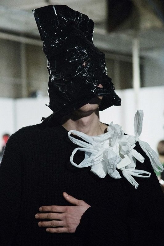 Corner shop carrier bag masks backstage at Christopher Shannon AW15 LCM. See more here: http://www.dazeddigital.com/fashion/article/23132/1/christopher-shannon-aw15-mens