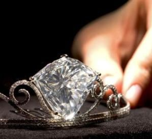 Alt view of Tiara with a shield-shaped diamond weighing 101.27 carats, set in brilliant-cut diamond extending scrolls, mounted in 18k white gold. The diamond is from the same mine as the Cullinan. by hester