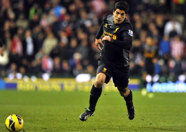 Liverpool's Uruguayan striker Luis Suarez chases the ball during the English Premier League football match between Stoke City and Liverpool at The Britannia stadium, Stoke-on-Trent, England, on December 26, 2012. Stoke City won the game 3-1