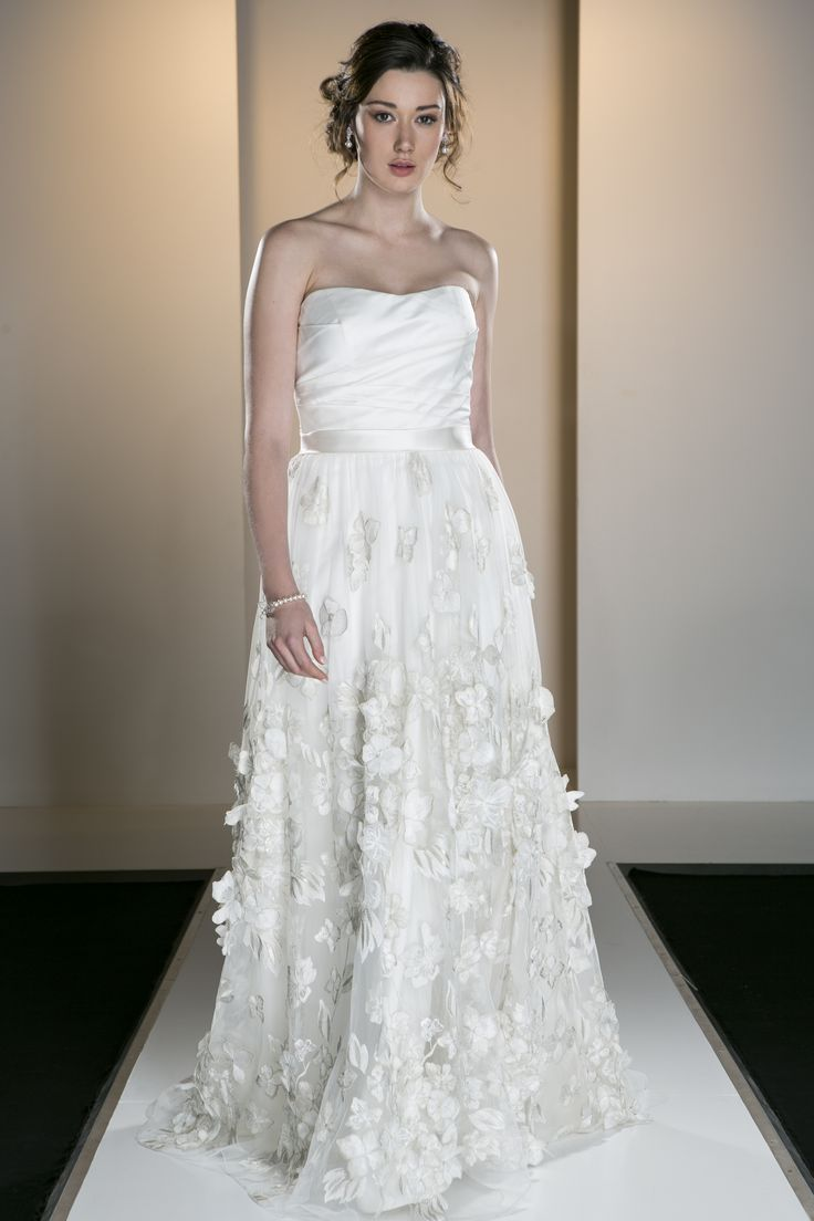 OCA 547T 'Addison' A structured and draped strapless gown in silk dupion and a 3D embroidered tulle flower skirt.