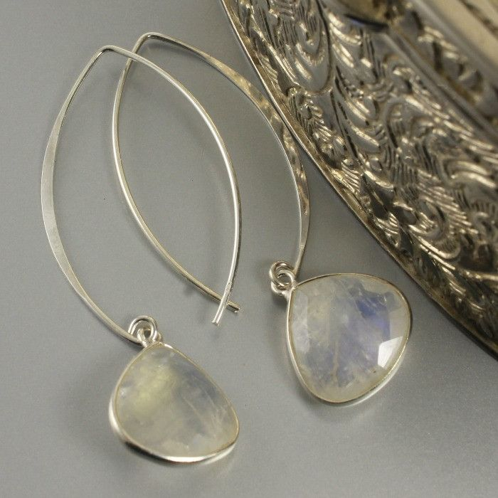 These stunning earrings are made with sterling silver bezel pear shaped moonstone gemstones and unique sterling silver, long marquise earring hooks. These earrings are suitable for everyday wear or fo