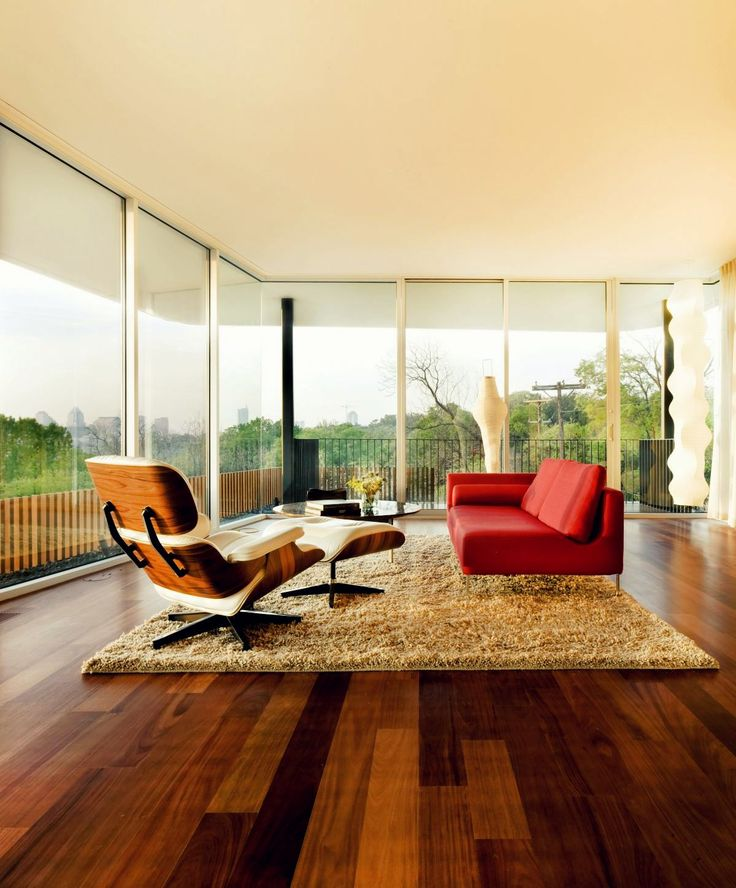 wood/glass interior with eames chair