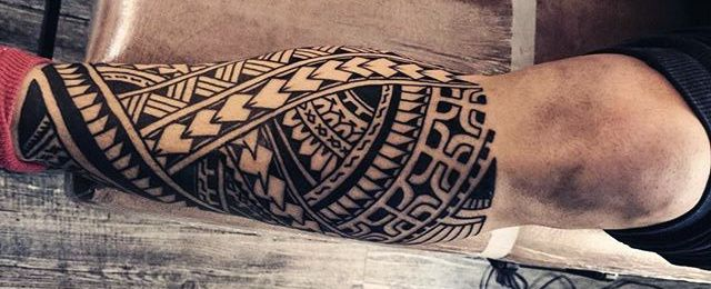 Discover jagged edges and interlaced patterns with the top 60 best tribal leg tattoos for men. Explore cool design ideas from Maori to Hawaiian and more.