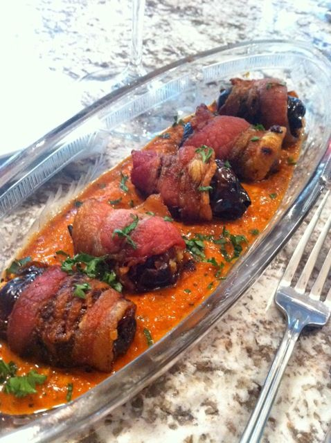Spanish Tapas Bacon Wraped Dates Stuffed with Manchego Cheese, Romesco Sauce