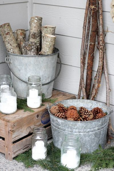 Rustic Winter White Porch by Design, Dining + Diapers: branches, pinecones & snow-filled mason jar candles.