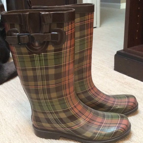SO CUTE RAIN BOOT! Unbelievably adorable rain boots that will brighten and make a splash to any rainy day! Gently worn but in really good condition! Cute buckle on outside. Muted green, pink and pale yellow with brown highlights!  Shoes Winter & Rain Boots
