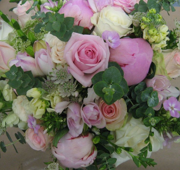 Romantic bouquet of pink and ivory roses, freesias, phlox, stocks, astrantia, dill, peonies and eucalyptus.