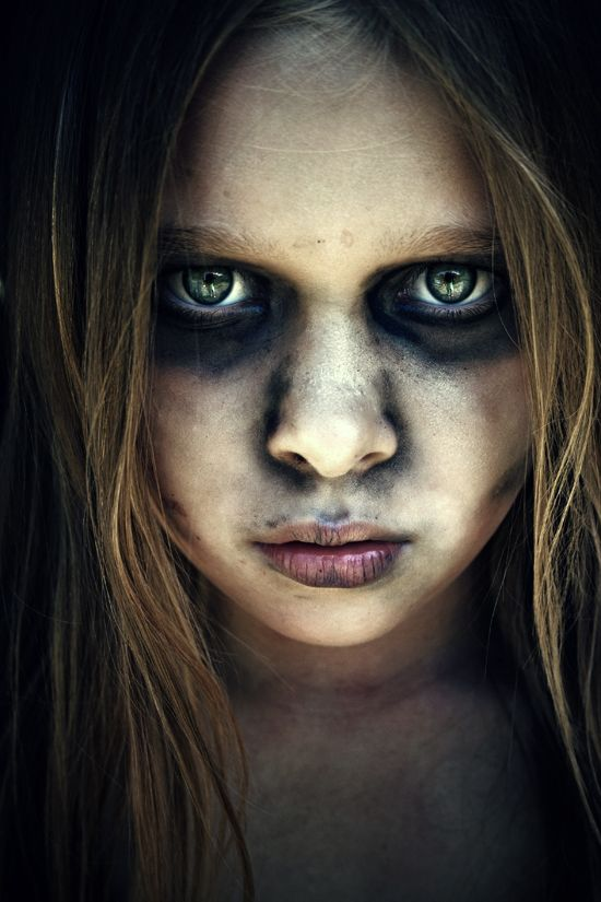 This little girl doesn't look as decomposed as most zombies but it's still haunting! By Mumbojumbo89 from Deviant Art