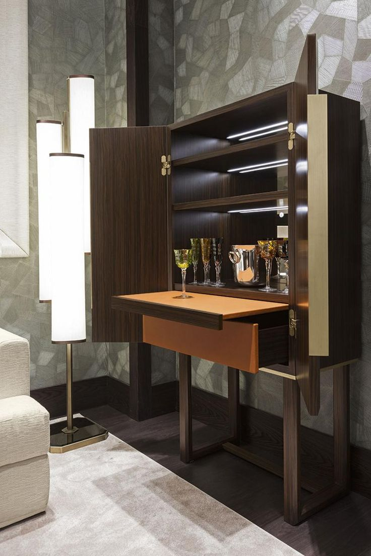The Laurent liquor cabinet by Oasis features doors and structure in Moka or Bolivar wood, with handles and decors in antique gold or bronze. The interior is a masterpiece of craftsmanship, with shelves which can be finished with a leather upholstery (optional), and internal LED lighting and presence detector (upon request).