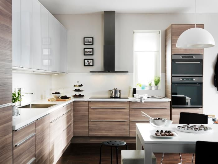 Ikea Kitchen, modern brown and white. I would do the Adel white on top