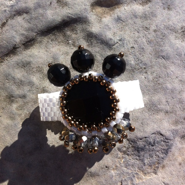 A ring made of black onix and peyotebeaden. Exclusively handmade.