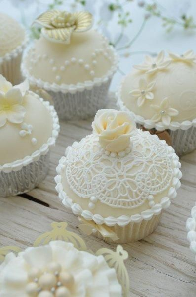 Ivory and white collection of wedding cupcakes. A mix of chocolate cherry sponge and vanilla buttermilk sponge.