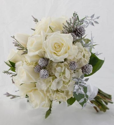Bridal Bouquet with pine cones and silver leaves for a winter wedding  #wedding