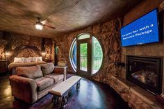 """Unique Eureka Springs hotel has """"cave"""" rooms, treehouse rooms, & castle rooms, luxuriously furnished with an eye to romance with fireplaces & Jacuzzis (photo shows Hobbit Cave room). They also have meeting & wedding venues. #Arkansas"""