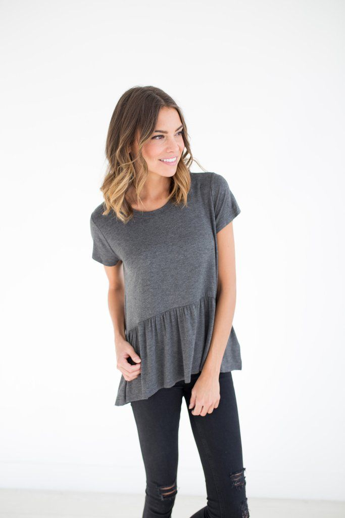 This charcoal colored peplum is the perfect neutral color and the softest and comfiest shirt you'll ever own. 95% Rayon, 5% Spandex Model is wearing a size small
