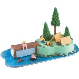 Fun nature details really make this cake work for kids. Easy add-ons like pretzel rod trees, a mini pretzel campfire and piping gel lake add a touch of the great outdoors.
