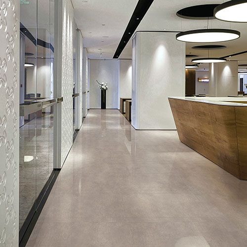 Modern kitchen with cream polished concrete effect porcelain floor tiles. #kitchen #tiles