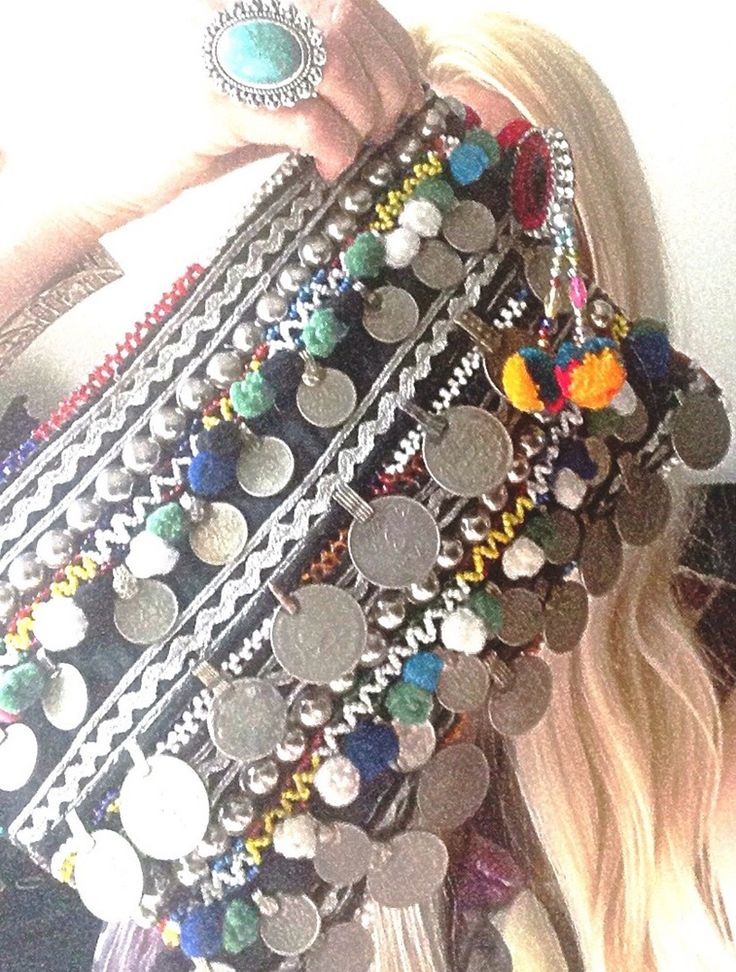 """Amazing OOAK Kuchi clutch bag!!This clutch bag is truly unique and is handmade, it has coin, Pom Pom, beads and metal studs embellishment on vintage textiles. Each bag is unique and therefore different coloursHas a zip closure a silver chain and lined inside.Dimensions 12"""" by 8"""""""