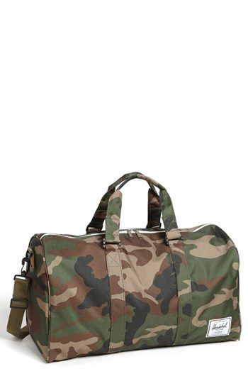 $80, Dark Green Camouflage Canvas Duffle Bag: Herschel Supply Co. Novel Duffel Bag Woodland Camo One Size. Sold by Nordstrom. Click for more info: https://lookastic.com/men/shop_items/81461/redirect