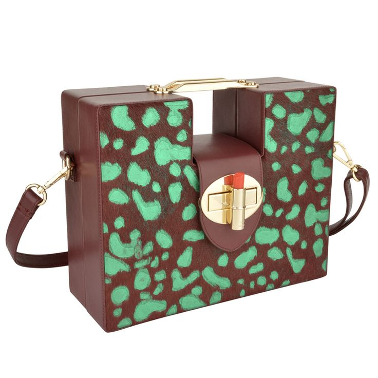 Iris-Purple-by-OYSBY Stylish Briefcase design made of a combination of duo coloured smooth hair on hide and smooth Napa leather finished with the signature OYSBY lipstick clasp closure.