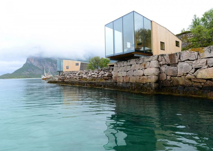 This boutique hotel on Norway's Manshausen Island is made up of four sea cabins that jut out from their natural ledge. Architect Snorre Stinessen carefully positioned them on an existing stone quay and built them to fit two to four travelers, or a family of five. To allow them to cantilever off the edge, their cross laminated timber floor plates are mounted onto two steel beams.